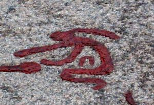 Bronze age petroglyph in Tanum, Sweden, showing woman weeping.